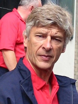 Arsenal manager Arsene Wenger and in the backg...