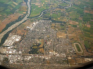 Aerial view of Ashburton, looking west. The Ashburton River or Hakatere is visible at left.