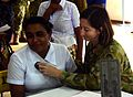 Australian Army Maj Kelly Stanton diagnoses a patient while participating in a medical exchange during Pacific Partnership 2017 Sri Lanka.jpg