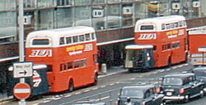 West London Air Terminal - Routemasters with orange and white livery towing luggage trailers outside Heathrow Terminal 2