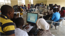 The Incubators Youth Outreach Network-Nigeria working with computers at a training programming center