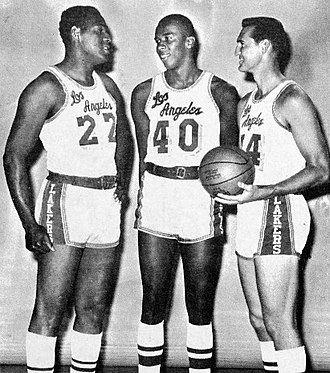 Elgin Baylor - Baylor standing next to teammates Jerry Chambers (center) and Jerry West (right), circa 1966