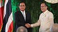 Benigno S. Aquino III shakes hands with General Prayut Chan-o-cha.jpg