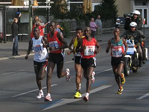 Charles Kamathi - Kamathi (right) with the leading pack at the Berlin Marathon