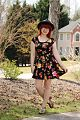 Black Floral Print Dress, Bronze Fisherman Sandals, and a Black Boater Hat (17064500769).jpg