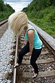 Blond woman on rail tracks 03.jpg