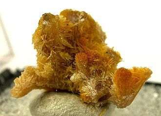 Boltwoodite - Acicular crystals of umber-yellow boltwoodite from Namibia (size: 1.8 x 1.7 x 1.4 cm)