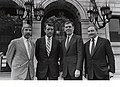 Boston Public Library Trustees Kevin F. Moloney and William O. Taylor, Mayor Raymond L. Flynn, Boston Public Library Director Arthur Curley in front of Boston Public Library (9501949105).jpg