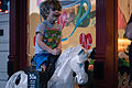 Boy Riding a Mechanical Horse in Fredericksburg, Texas (2015-02-14 18.21.59 by Nan Palmero).jpg