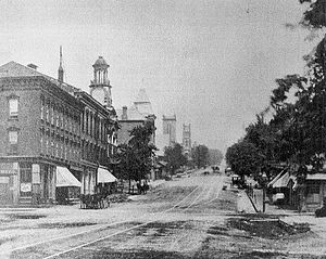 Col. Joseph Young Block - The Col. Young Block is the first building on the left in this 1880 photograph. Note the cornice that was later removed.