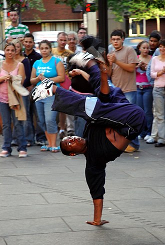 Breakdancing - A b-boy performing outside Faneuil Hall, Boston, United States