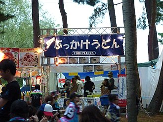 Bukkake - In Japanese, the word bukkake has extensive non-sexual use, such as this food tent advertising bukkake udon noodles.