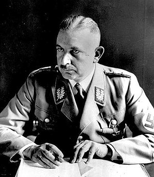 Ranks and insignia of the Nazi Party - Gauleiter Bernhard Rust wearing a mid-1930s Nazi Party jacket with shoulder boards and collar patches