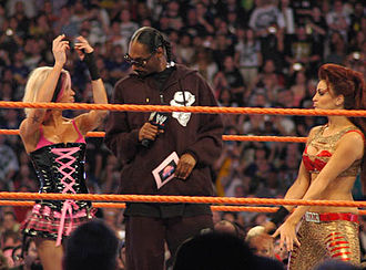 Ashley Massaro - Ashley along her tag team partner Maria and Master of Ceremonies Snoop Dogg at WrestleMania XXIV.