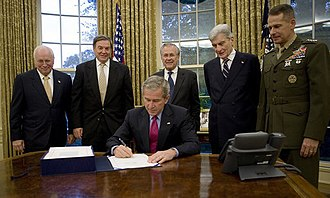 John Warner - President George W. Bush signs into law H.R. 5122, the John Warner National Defense Authorization Act for Fiscal Year 2007 in the Oval Office at the White House. Joining him are, from left: Vice President Dick Cheney, Rep. Duncan Hunter of California, Secretary of Defense Donald Rumsfeld, Sen. John Warner of Virginia, and General Peter Pace, Chairman of Joint Chiefs of Staff.