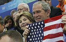 Bushes cheer Olympic swimmers with flag.jpg