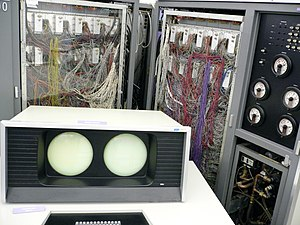 CDC 6000 series - CDC 6600 computer. Display console shown in the foreground, main system cabinet in background, with memory/logic/wiring to the left and middle, and power/cooling generation and control to the right.