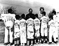 Carl Albert speaking with a young baseball team.jpg