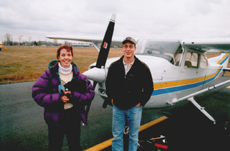 Flight training - A Canadian aeroplane flight instructor (left) and her student, next to a Cessna 172 with which they have just completed a lesson.