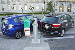 Two Plug In Electric Cars A Honda Fit EV All Car Left And Ford C Max Energi Hybrid Right Charging From An On Street Public