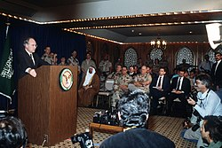 Secretary of Defense Cheney during a press conference regarding the Gulf War.