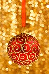 Christmas-bauble-on-gold-11289575412UeK