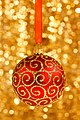 Christmas-bauble-on-gold-11289575412UeK.jpg