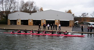 Churchill College Boat Club - Churchill M1 passing the boathouse during the Fairbairns Cup, November 2007.