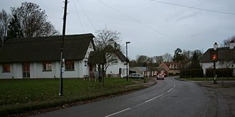 Madingley - High street with village hall (left) and pub sign