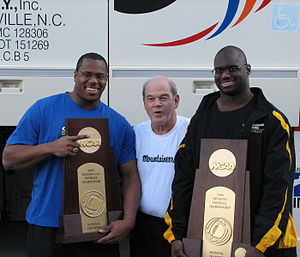 Jerry Moore (American football, born 1939) - Moore with two Appalachian State players following the 2006 NCAA Division I Football Championship Game.