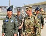 Col. Mark Holler, 35th Air Defense Artillery Brigade commander, right, gives a tour of a Patriot firing battery tactical site with Commander, Republic of Korea Air Force Operations, Lt. Gen. Wang Keun Lee.jpg