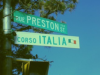 Official bilingualism in Canada - Bilingual (French/English) sign for Preston Street (rue Preston) in Ottawa, placed above a sign marking that the street is in Little Italy. An example of bilingualism at the municipal government level.