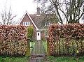 Cottage behind beech hedge in Dickleburgh Moor - geograph.org.uk - 1779567.jpg
