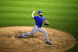 Cubs starter Jake Arrieta delivers a pitch in the first inning of World Series Game 6. (30634554251).jpg