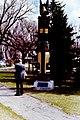 Dad looking at a Kawkiutl Totem Pole at the Manitoba Legislative Buildings (7208164064).jpg