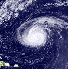 A satellite image depicting a mature hurricane with a well-defined eye far away from landmasses.