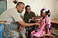 Defense.gov News Photo 100430-A-1526R-164 - U.S. Army Maj. Jose Rivera a doctor with the 94th Combat Support Hospital left works alongside a Uruguayan Navy nurse to examine a young Haitian.jpg