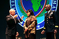 Defense.gov News Photo 110309-D-XH843-006 - Secretary of Defense Robert M. Gates presents Joyce Ward wife of outgoing commander of U.S. Africa Command Army Gen. William Ward with the.jpg