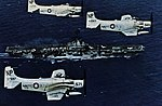 Douglas A-1 Skyraiders of VA-215 in flight over USS Hancock (CVA-19), circa in 1963.jpg