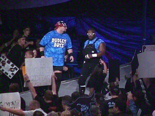Buh Buh Ray Dudley and D-Von Dudley in 1999, wearing the Dudley Brothers' signature tie-dye shirts, overalls and glasses Dudley Boys 1999 WWF Smackdown (WWE).jpg