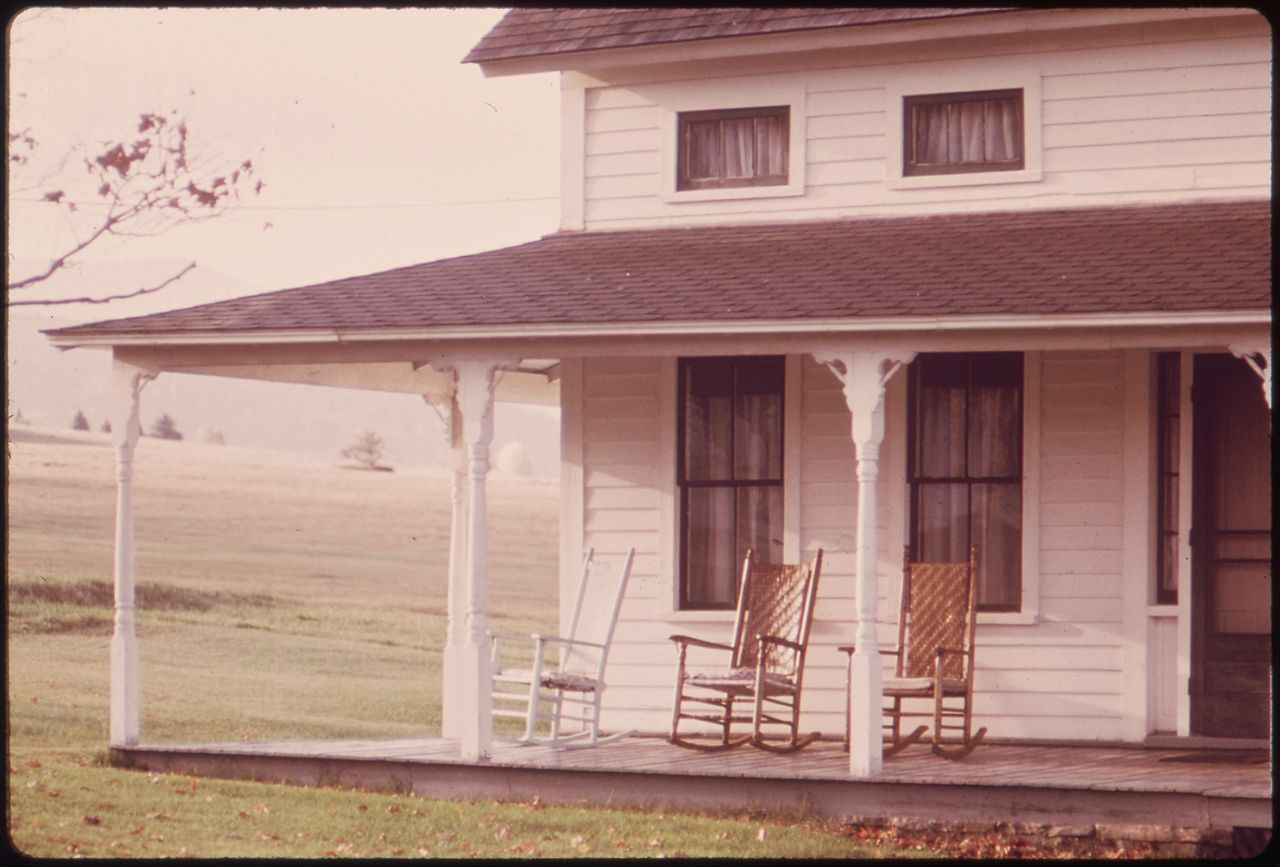 FileEMPTY ROCKING CHAIRS ON AN OLD FARMHOUSE PORCH ROUTE 73