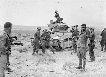 New Zealander soldiers recapture a Matilda tank and take prisoner its German crew during Operation Crusader, 3 December 1941. E 003743 E.jpg