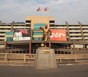 "Estadio Monumental ""U"" - Front entrance of the stadium where the statue dedicated to Teodoro Fernández can be seen."