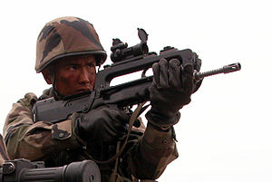 FAMAS - Soldier of the 2nd Foreign Infantry Regiment using FAMAS Infanterie upgraded with an Aimpoint red dot sight