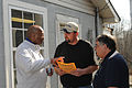 FEMA - 34390 - FEMA workers and Small Business Administration specialist meet in the field.jpg