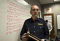 FEMA - 40640 - FEMA Public Information Officer attending action briefing in St. Paul, MN.jpg