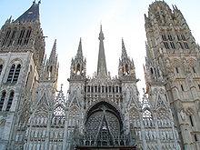 https://upload.wikimedia.org/wikipedia/commons/thumb/e/e3/Facade_de_la_Cath%C3%A9drale_de_Rouen_au_matin.jpg/220px-Facade_de_la_Cath%C3%A9drale_de_Rouen_au_matin.jpg