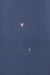 Falcon Heavy side boosters landing at KSC 05.jpg