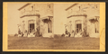 Family posing in front and in the balcony of stone house, from Robert N. Dennis collection of stereoscopic views 14.png