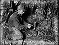 File-C4058--Unknown location--Coal mine scene--Man with lamp -1917.05.14- (9a84cdbc-6f12-43a1-9c85-26cf6ca2f774).jpg